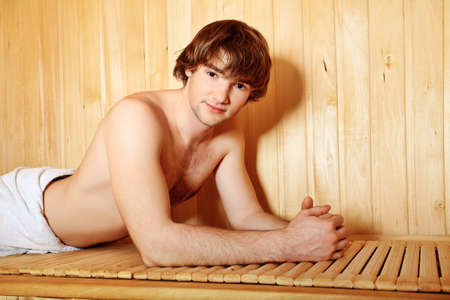 Handsome young man relaxing in the sauna. Beauty, healthcare. photo