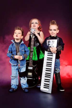 harmonist: Group of children singing in heavy metal style. Shot in a studio.