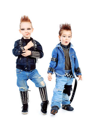 hardrock: Shot of two little boys singing rock music in studio. Isolated over white background.