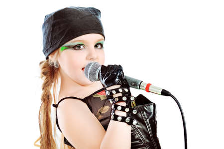 Shot of a little girl singing rock music with a microphone. Isolated over white background. photo