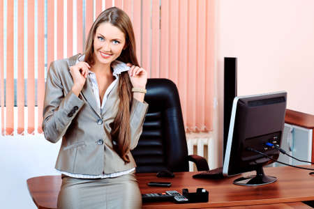 Beautiful business woman is working at the office. Reklamní fotografie