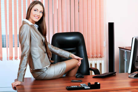 sexy businesswoman: Attractive business woman is working at the office.
