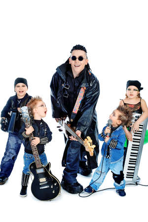 Heavy metal musician  with a group of stylish children. Shot in a studio. Isolated over white background. photo