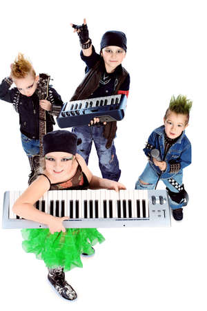 Group of children singing in heavy metal style. Shot in a studio. Isolated over white background. photo