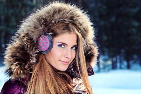 Beautiful young woman in winter clothes outdoor. Stock Photo