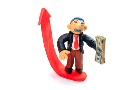 Shot of a plasticine businessman in a suit holding money. Isolated over white background. photo
