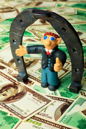 Shot of a plasticine businessman in a suit. Over money background. Stock Photo - 9263356