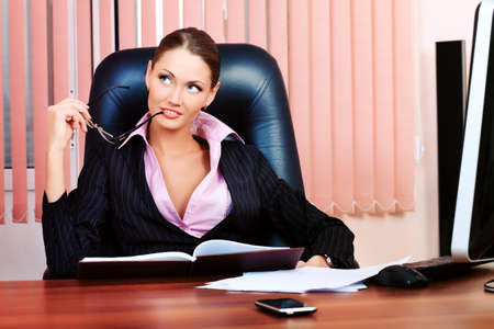 Beautiful business woman is working at the office. Stock Photo - 9263249