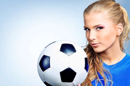 female soccer: Shot of a sporty young woman with a ball. Active lifestyle, wellness.