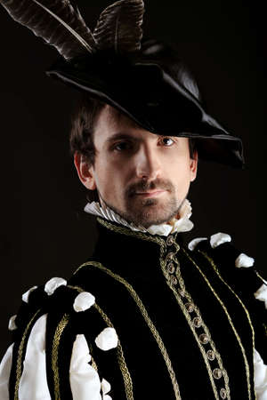 Portrait of a handsome man grandee in 16th century costume. Shot in a studio.