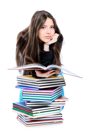 Portrait of a girl teenager reading book. Isolated over white background. Stock Photo - 9296806