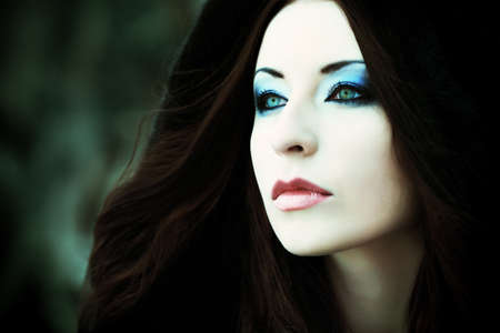 gothic: Shot of a gothic woman in a winter park. Fashion. Stock Photo