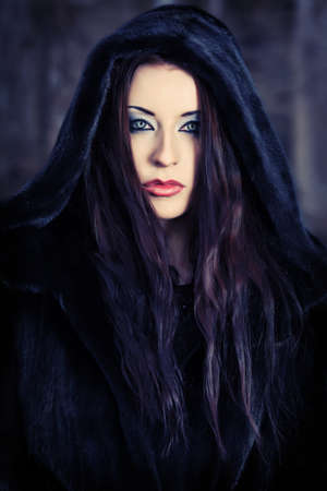 dismal: Shot of a gothic woman in a winter park. Fashion. Stock Photo