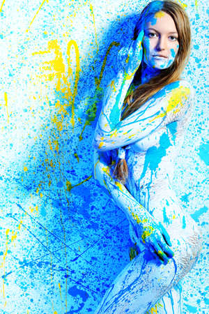 Art project: beautiful woman painted with many vivid colors. Stock Photo - 9296932