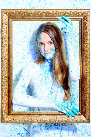 Art project: beautiful woman painted with many vivid colors.  photo