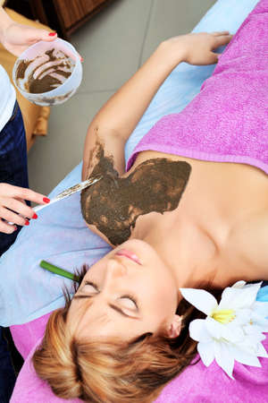Beautiful young woman getting spa treatment at a salon. Beauty, healthcare. photo