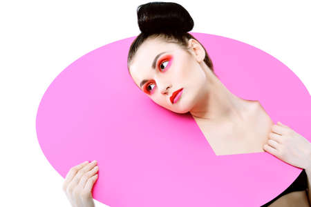 Fashion shot of an attractive model. Make-up. Shapes concept. Isolated over white background. Stock Photo - 9321874