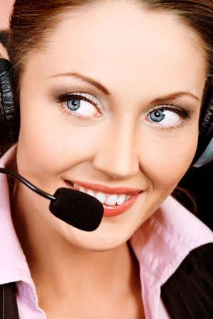 Beautiful customer service operator woman with headset photo