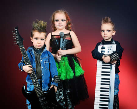 Group of children singing in heavy metal style. Shot in a studio. Stock Photo - 9321986