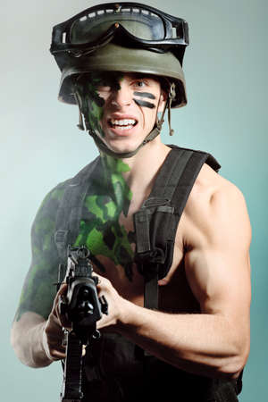 khaki: Shot of a conceptual soldier painted in khaki colors. Studio shot.