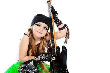 Shot of a little girl playing rock music with electric guitar. Isolated over white background. photo