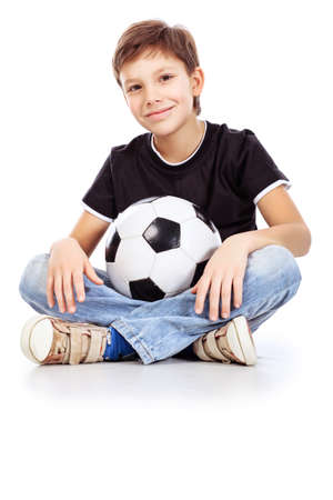 Portrait of a boy with a ball. Isolated over white background. photo