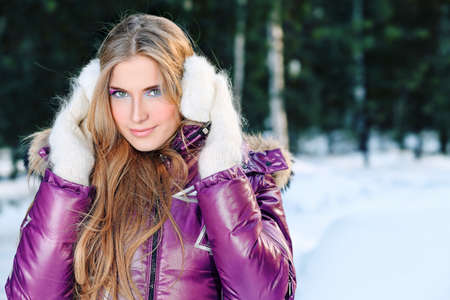 attracive: Beautiful young woman in winter clothes outdoor. Stock Photo