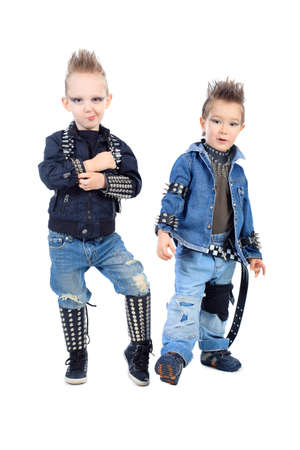 hot of two little boys singing rock music in studio  Isolated photo