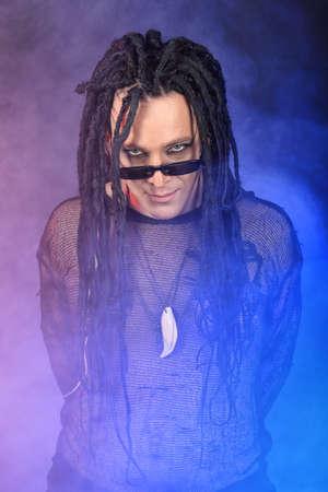 Portrait of a heavy metal musician. Shot in a studio. photo