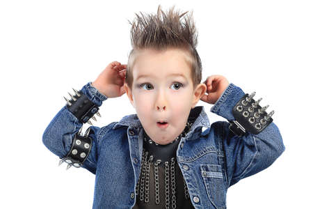 hardrock: Shot of an emotional little boy wearing rock music clothes. Isolated over white background.
