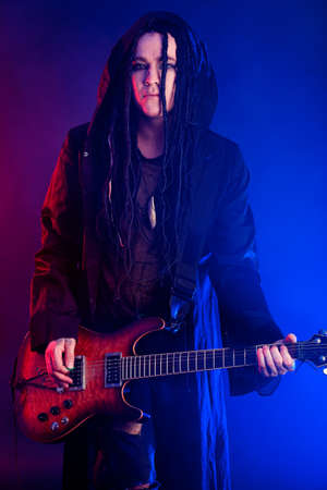 Heavy metal musician  is playing electrical guitar. Shot in a studio. Stock Photo - 9379708