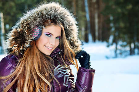 fur hood: Beautiful young woman in winter clothes outdoor. Stock Photo