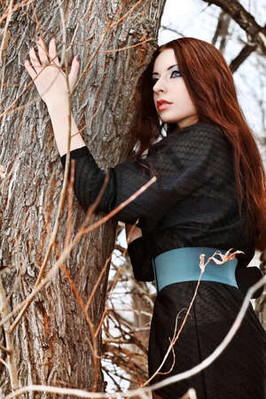 Shot of a gothic woman in a winter park. Fashion. Stock Photo - 9430659