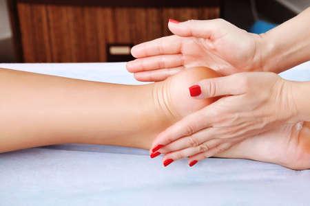 Shot of spa salon, reflexology foot massage. photo