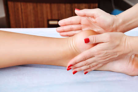 restore energy flow: Shot of spa salon, reflexology foot massage.