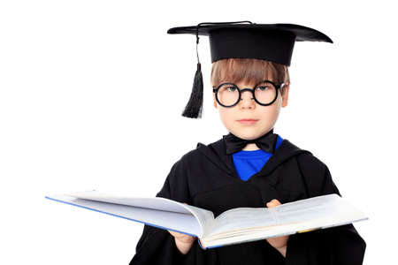 graduating: Cute little boy in graduation gown Stock Photo