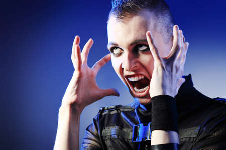 skinhead: Shot of a shouting skinhead man.