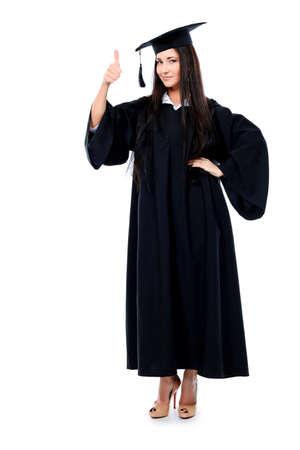 absolwent: Motyw edukacyjne: graduating dziewczyna studentów w gown akademickich. Samodzielnie na biaÅ'ym tle. Zdjęcie Seryjne