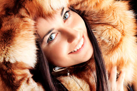 Portrait of a beautiful young woman in a fur. Stock Photo - 9454593