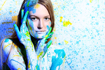 Art project: beautiful woman painted with many vivid colors.  Stock Photo - 9454695