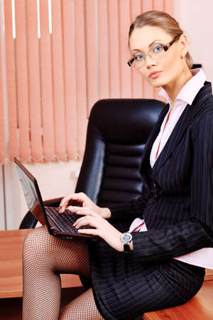 Attractive business woman is working at the office. Stock Photo - 9454745