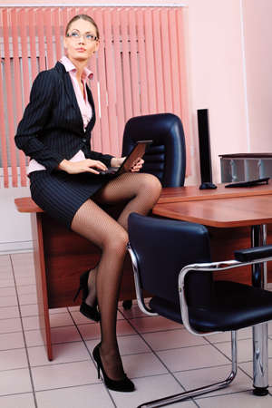 strict: Attractive business woman is working at the office