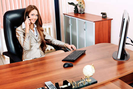 Beautiful business woman is working at the office  photo