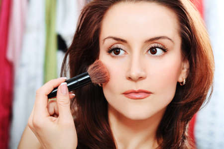Young beautiful woman making up at home. Stock Photo - 9490152