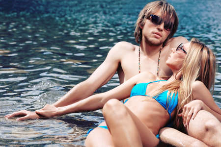 Happy young couple having a rest on a beach. Stock Photo - 9490198