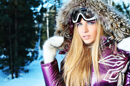 to ski: Pretty young woman having winter rest outdoor. Stock Photo
