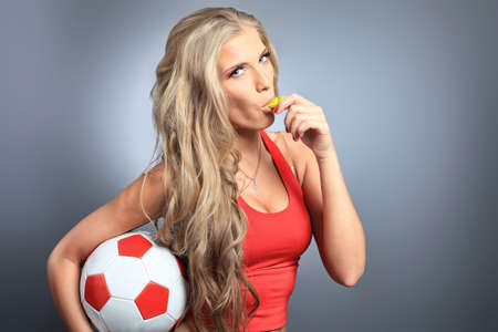 whistles: Shot of a sporty young woman with a ball. Active lifestyle, wellness.