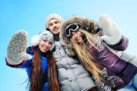 Group of young people having a rest outdoor in winter. photo