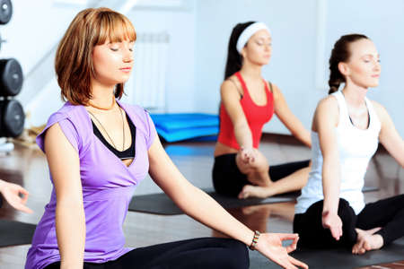 adult class: Group of young women in the gym centre. Yoga.