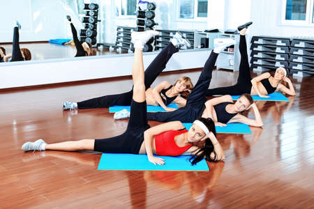 lithe: Group of young women in the gym centre.